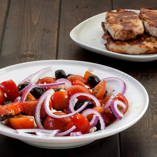 Simple Greek salad with a side of... pork!