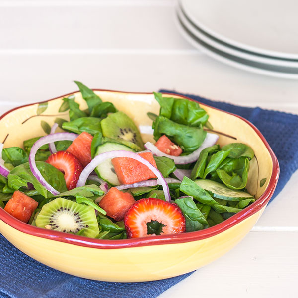 This perfect mix of different fruits and spinach, makes for the most refreshing summer salad.