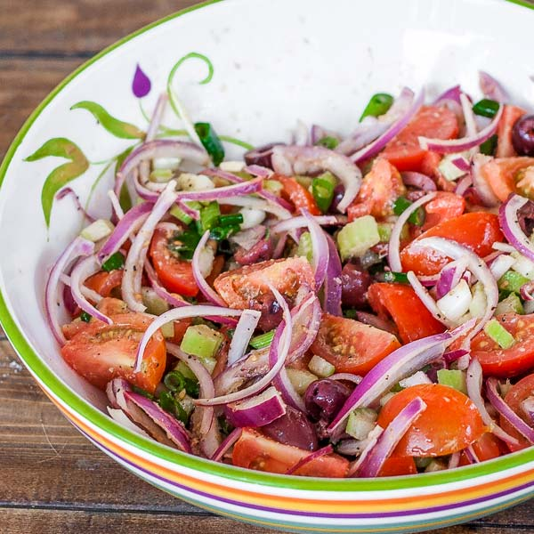 Simple salad with Campari tomatoes, red onion, celery and loads of oregano