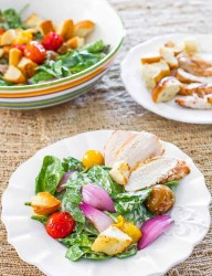 Chicken Caesar salad with roasted tomatoes