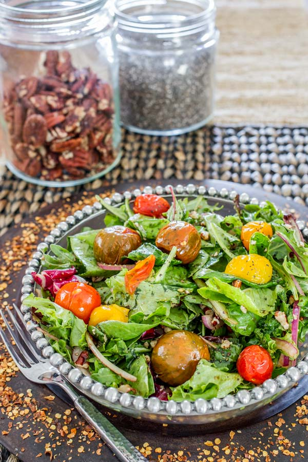 Tasty and colorful mixed greens salad topped with roasted tomatoes and drizzled with a sweet balsamic vinaigrette.