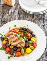 Delicious grilled chicken with roasted tomatoes and olives