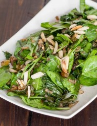 Healthy salad made with kale, Swiss chard and spinach, served warm