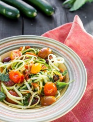 Vegetarian dish made with zucchini pasta and roasted tomatoes