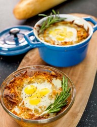 Baked quail eggs into a potato hash basket