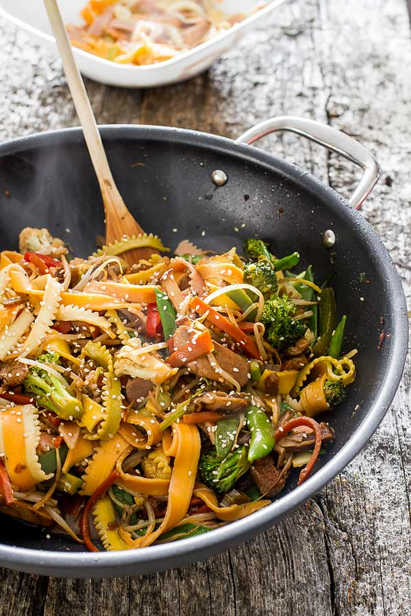 Easy chicken stir-fry recipe, loaded with various vegetables and colorful riccia pasta