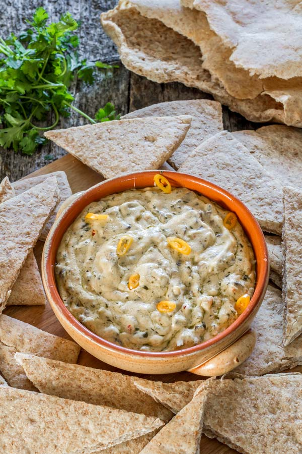 Delicious appetizer featuring three types of cheese in combination with sauteed mushrooms and pesto, perfect dip for those pita chips.